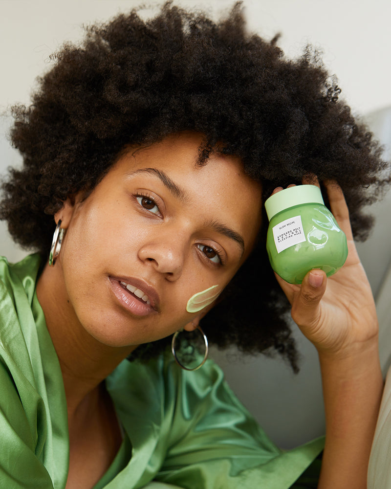 model with avocado melt retinol face sleeping mask and swatch on face