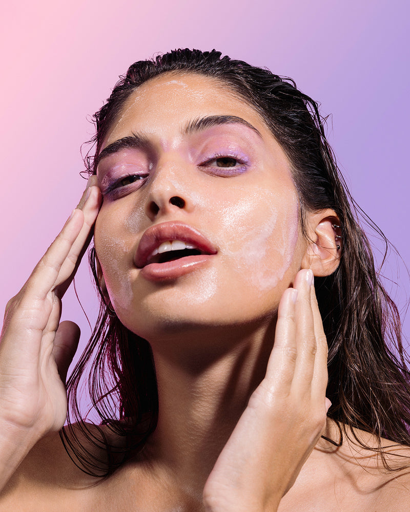 model removing makeup with blueberry bounce cleanser