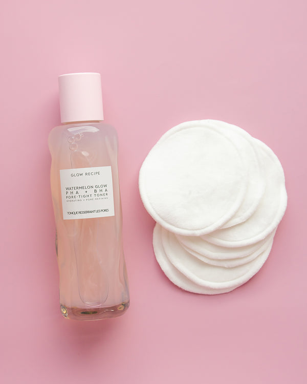 7-pack reusable cotton pads next to watermelon glow PHA + BHA pore-tight toner on pink backdrop