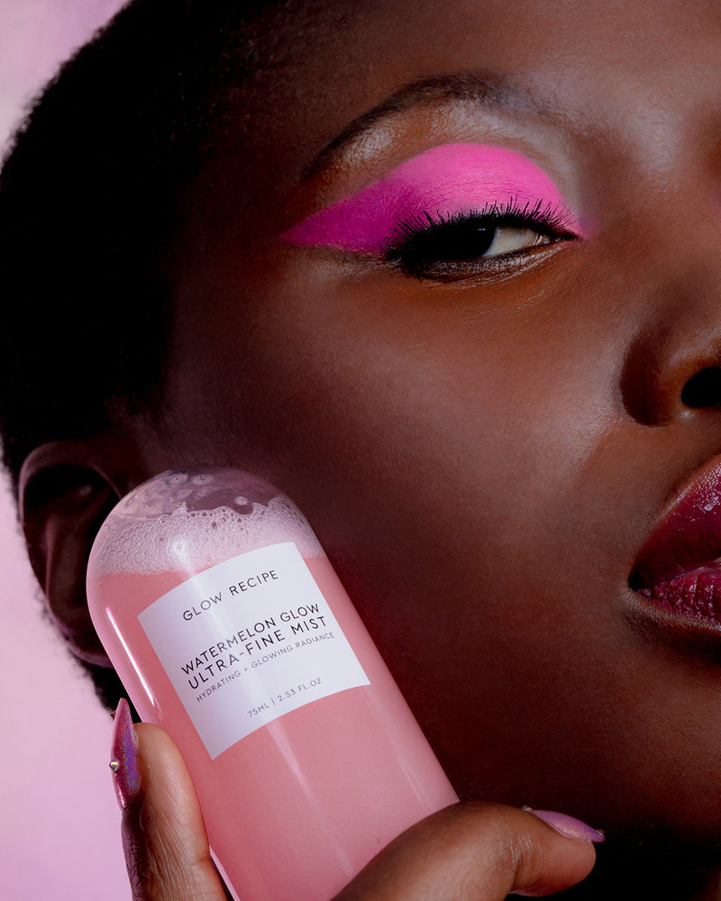 model with pink eyeshadow holding pink watermelon glow ultra fine mist