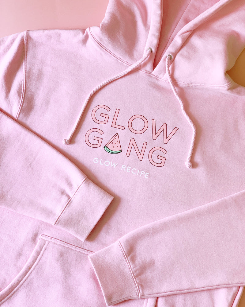 glow gang hoodie on pink backdrop