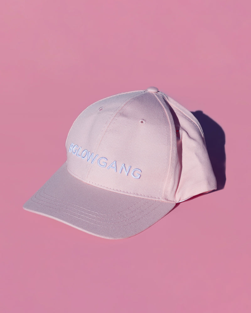 glow gang baseball cap on pink backdrop
