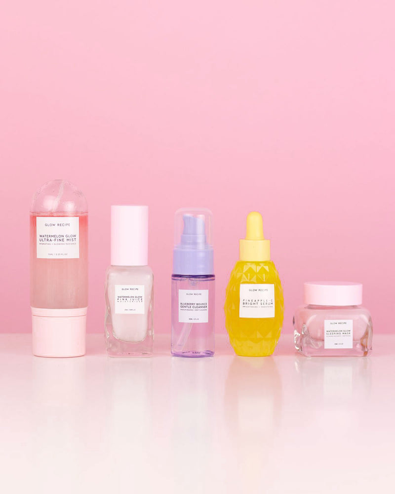 glowipedia glass skin kit with five glow recipe products against pink backdrop