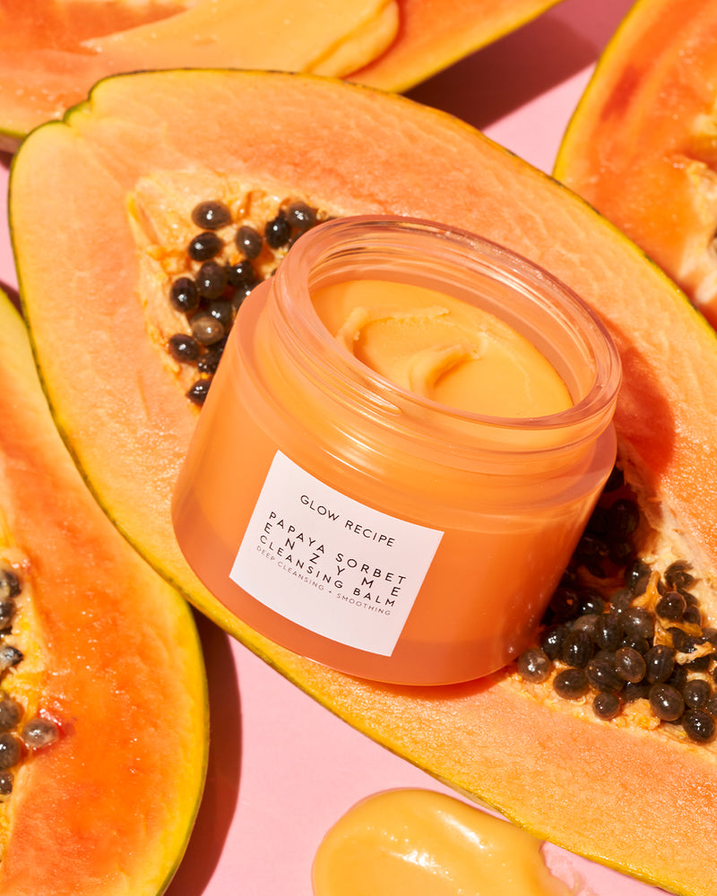 Papaya sorbet enzyme cleansing balm opened on papaya fruit