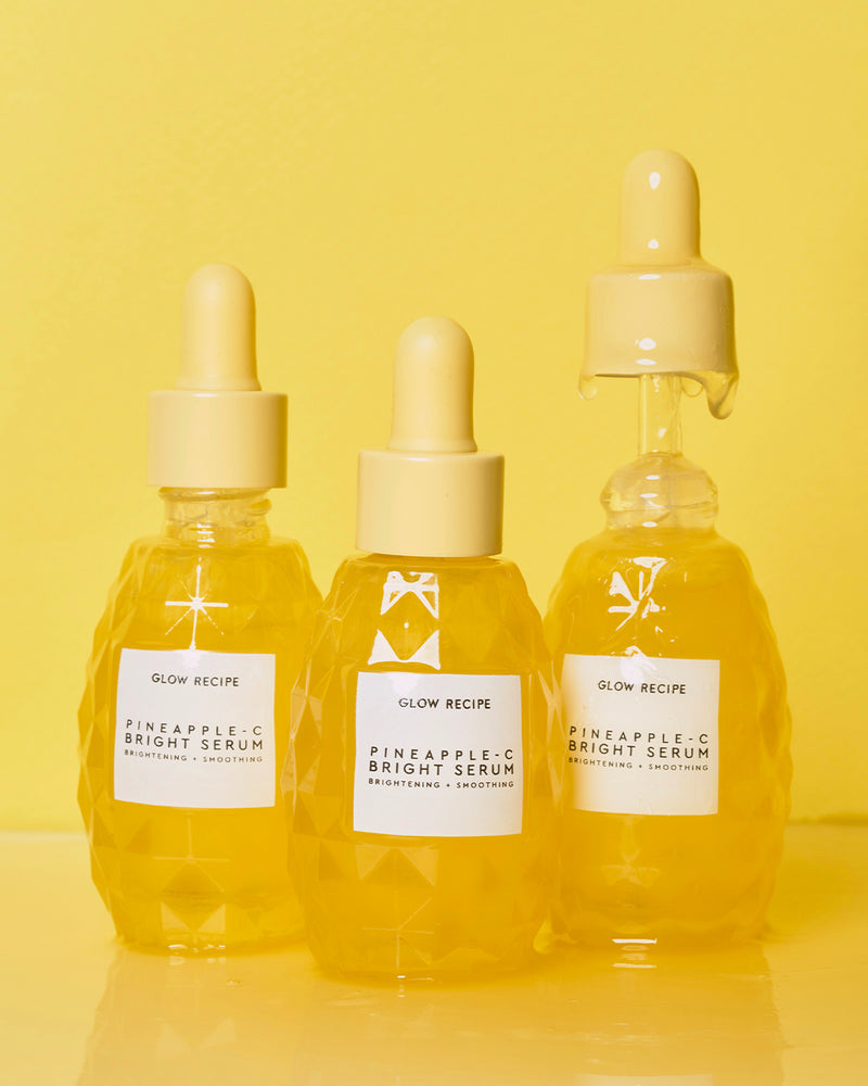 multiple pineapple-C bright serum bottles with serum dripping from dropper cap