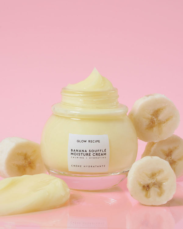 Banana soufflé moisture cream on pink backdrop with fresh bananas