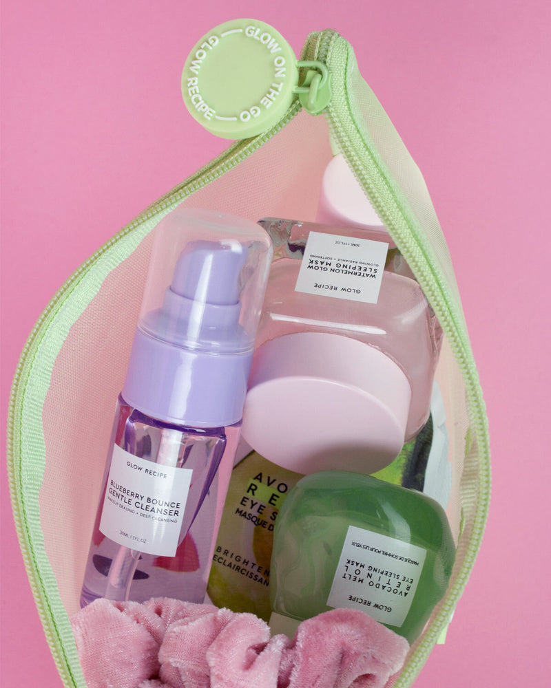glow recipe products in unzipped green zip against pink backdrop
