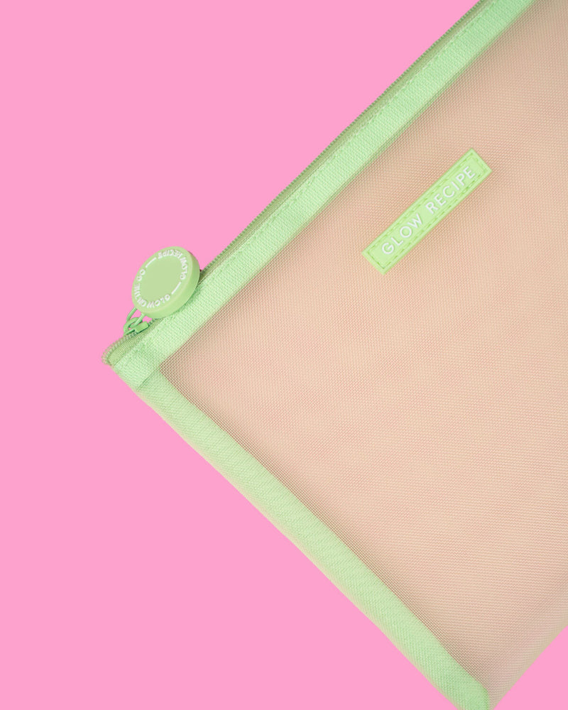 closer shot of green mesh zip on pink backdrop