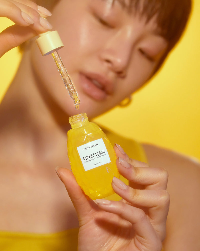 model dispensing pineapple-C bright serum with dropper into bottle
