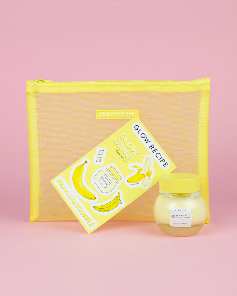 banana soufflé moisture cream and banana stickers in front of yellow mesh zip against pink backdrop
