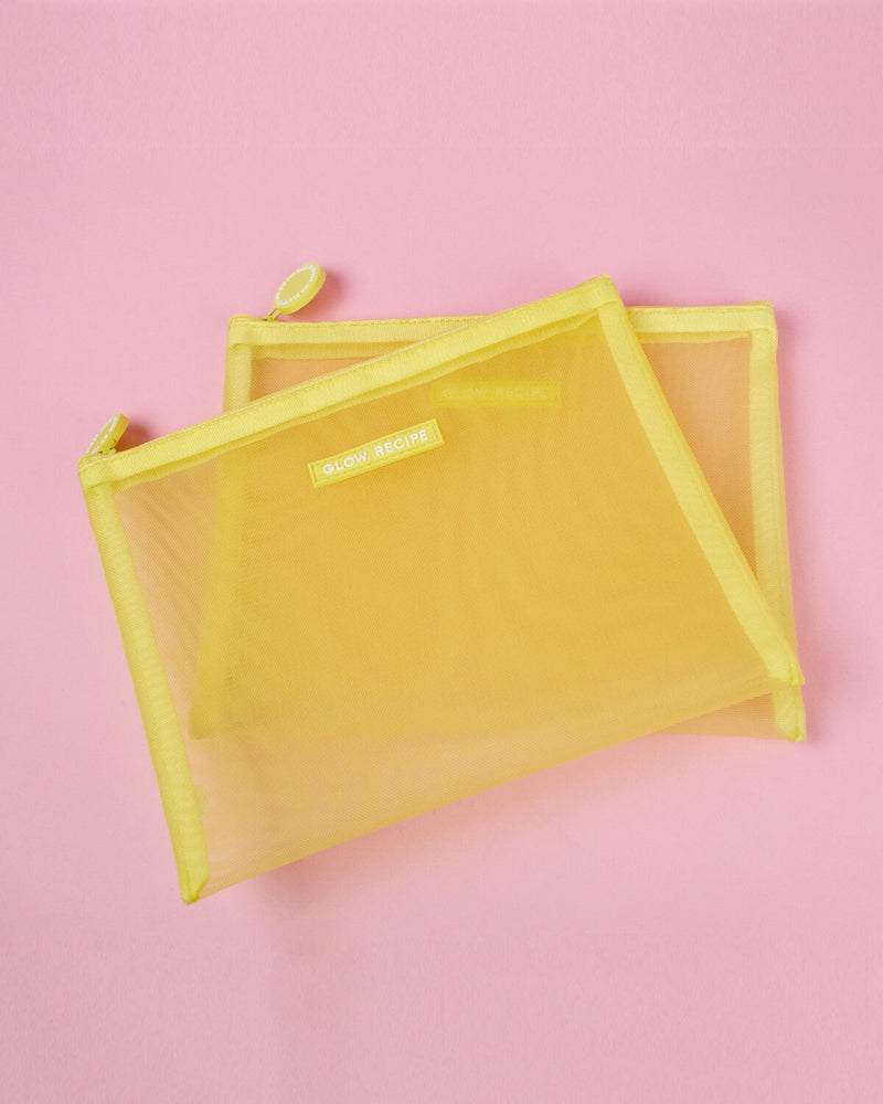 yellow mesh zips against pink backdrop