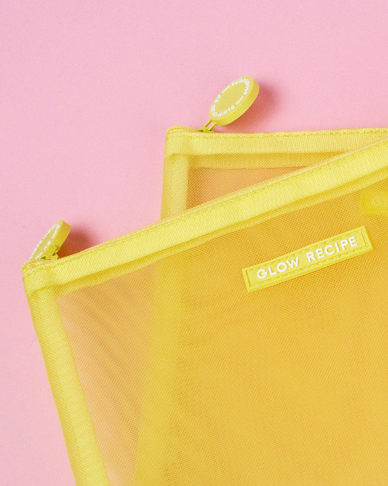 yellow mesh zip against pink backdrop