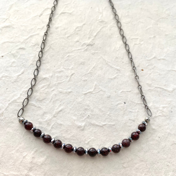 Deep Red Garnet and Hematite Beads on a Gray Chain