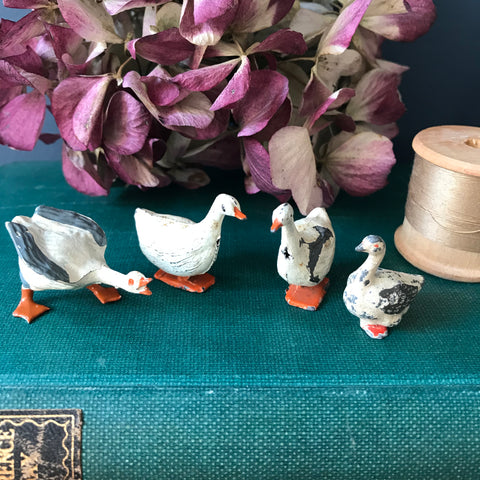 Vintage collection of four die cast miniature white geese