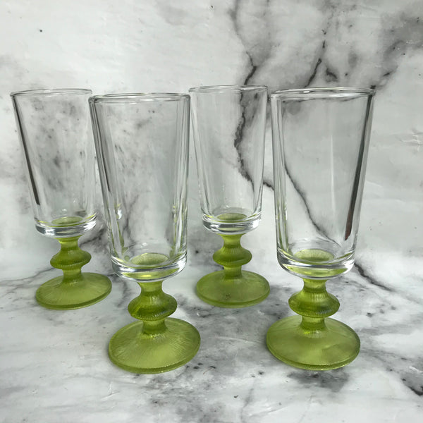 Four 1970s sherry glasses with green base