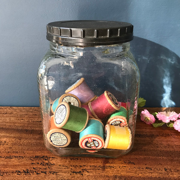 Large mid century glass storage jar with black plastic lid