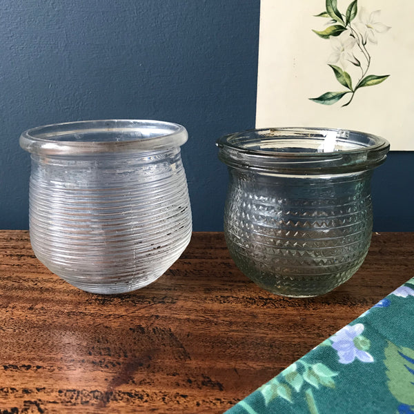 Two 1920s glass honey jars