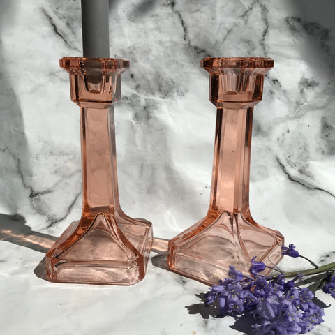 Pale pink glass vintage candlesticks with a square base
