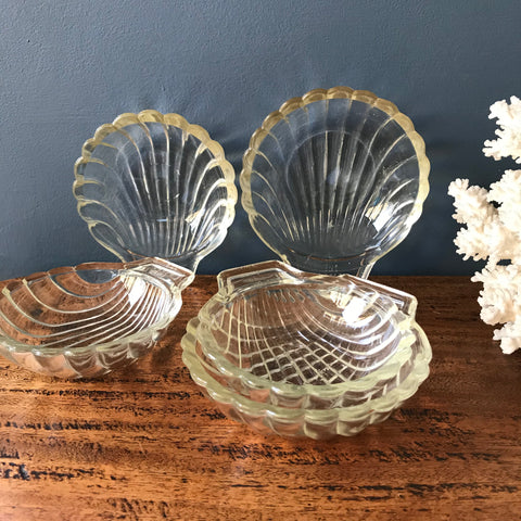 Five Pyrex glass shell shaped dishes