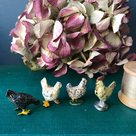 Collection of four die cast miniature lead chickens
