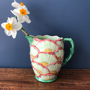 Falcon Ware ceramic jug decorated in floral fan shapes in green pink and yellow