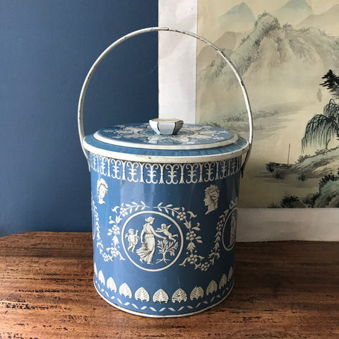 blue and white biscuit tin with handle