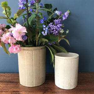 Pair of English stoneware jars in different sizes with striped patterns