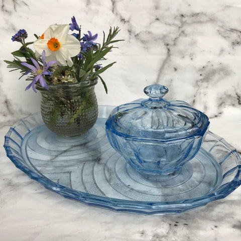 Blue glass dressing table tray with lidded jar