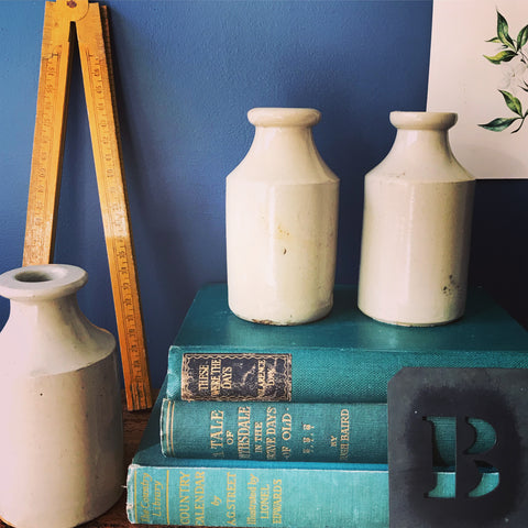Set of three ceramic cream bottles