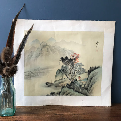 An unframed watercolour painting depicting a Japanese scene of a lake, mountains and trees