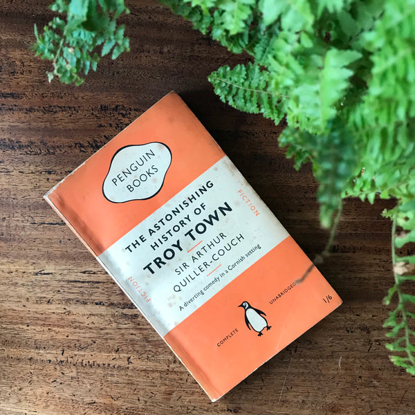 1950s orange and green Penguin book collection