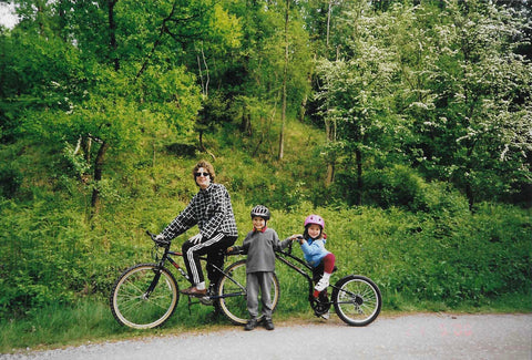 David and Jess cycling as children