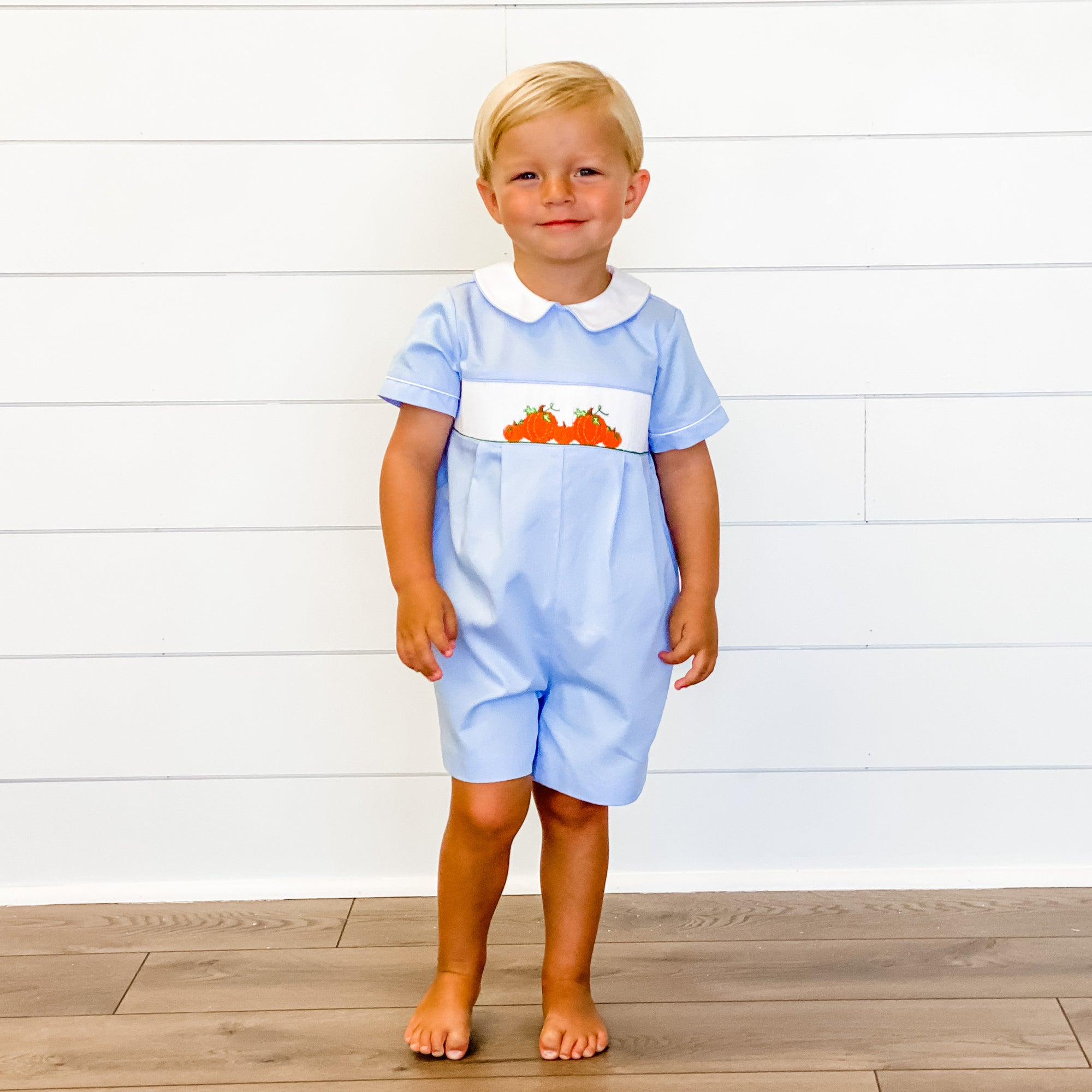 Smocked Pumpkin Patch Collared Boy Bubble - Light Blue Pique - Stellybelly