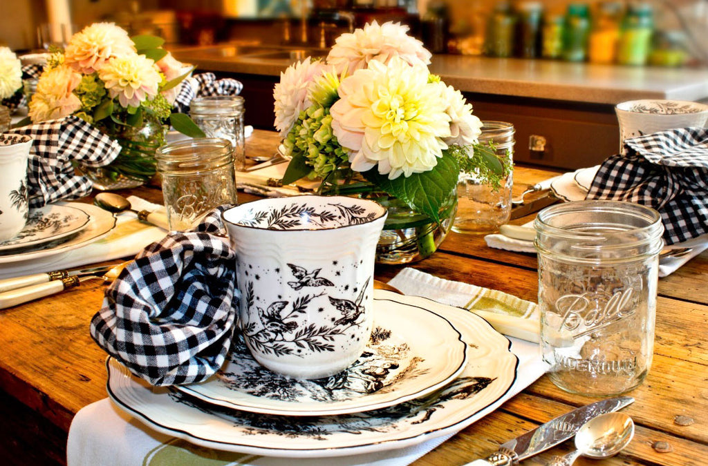 Black and White Toile on a table with green and white kitchen towels as a placemat