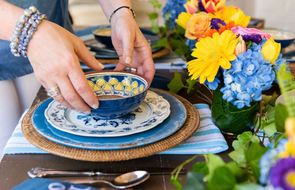 Blue and White Kitchen Towels on a Table as placemats