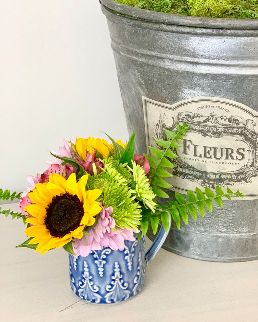Flowers in a Creamer Pitcher