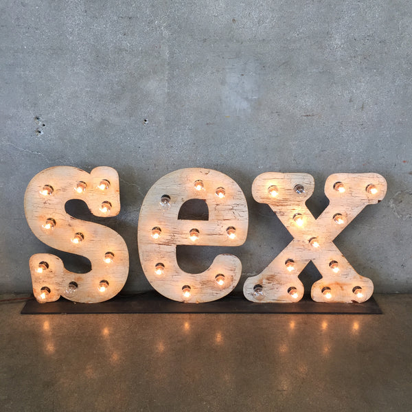 Lighted Metal Sex Sign
