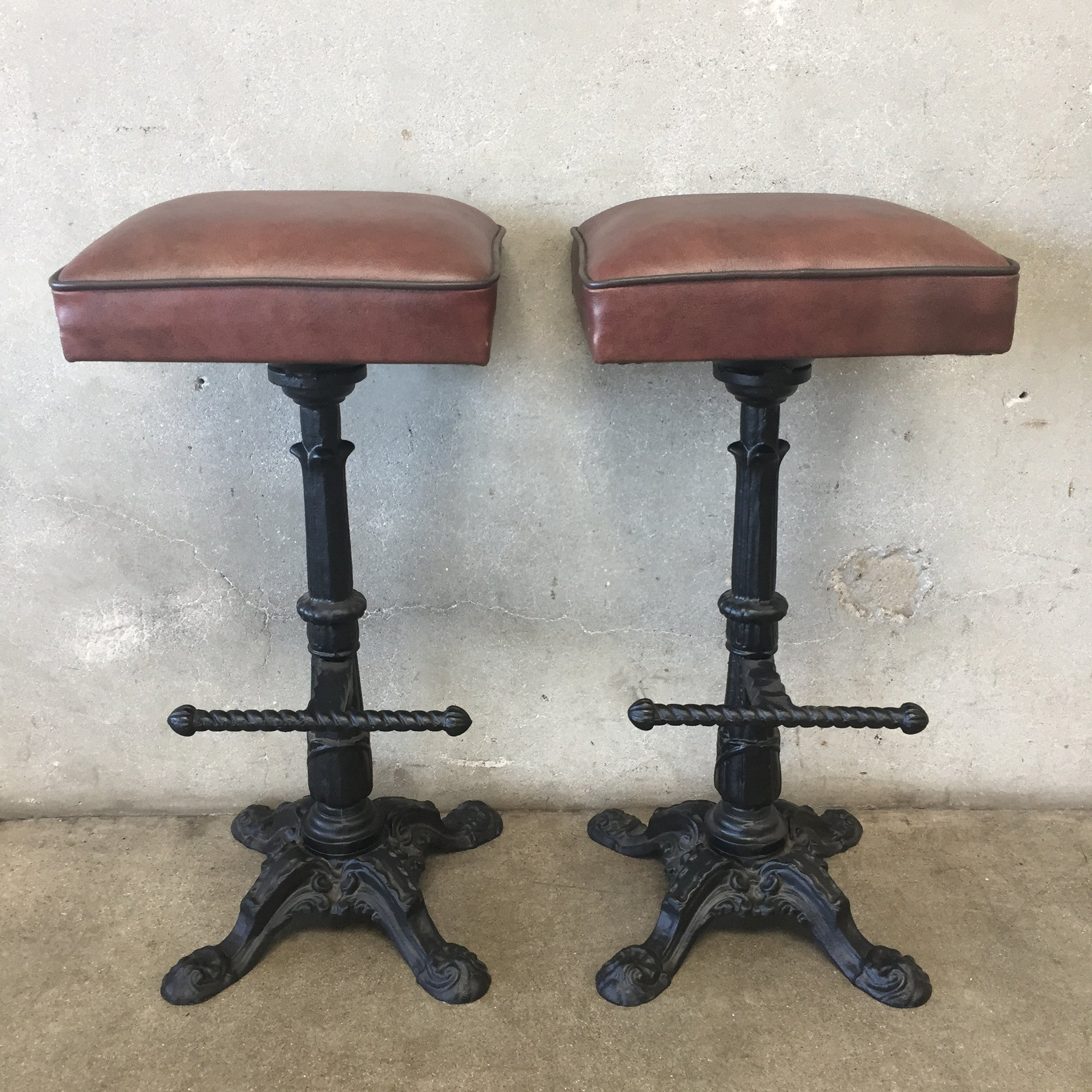 Pair of antique cast iron bar stools