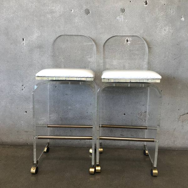 Pair of Mid Century Lucite Swivel Chairs on Casters