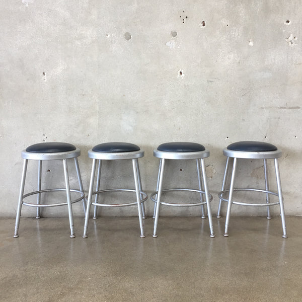 Set of Four Industrial Stools with Adjustable Legs