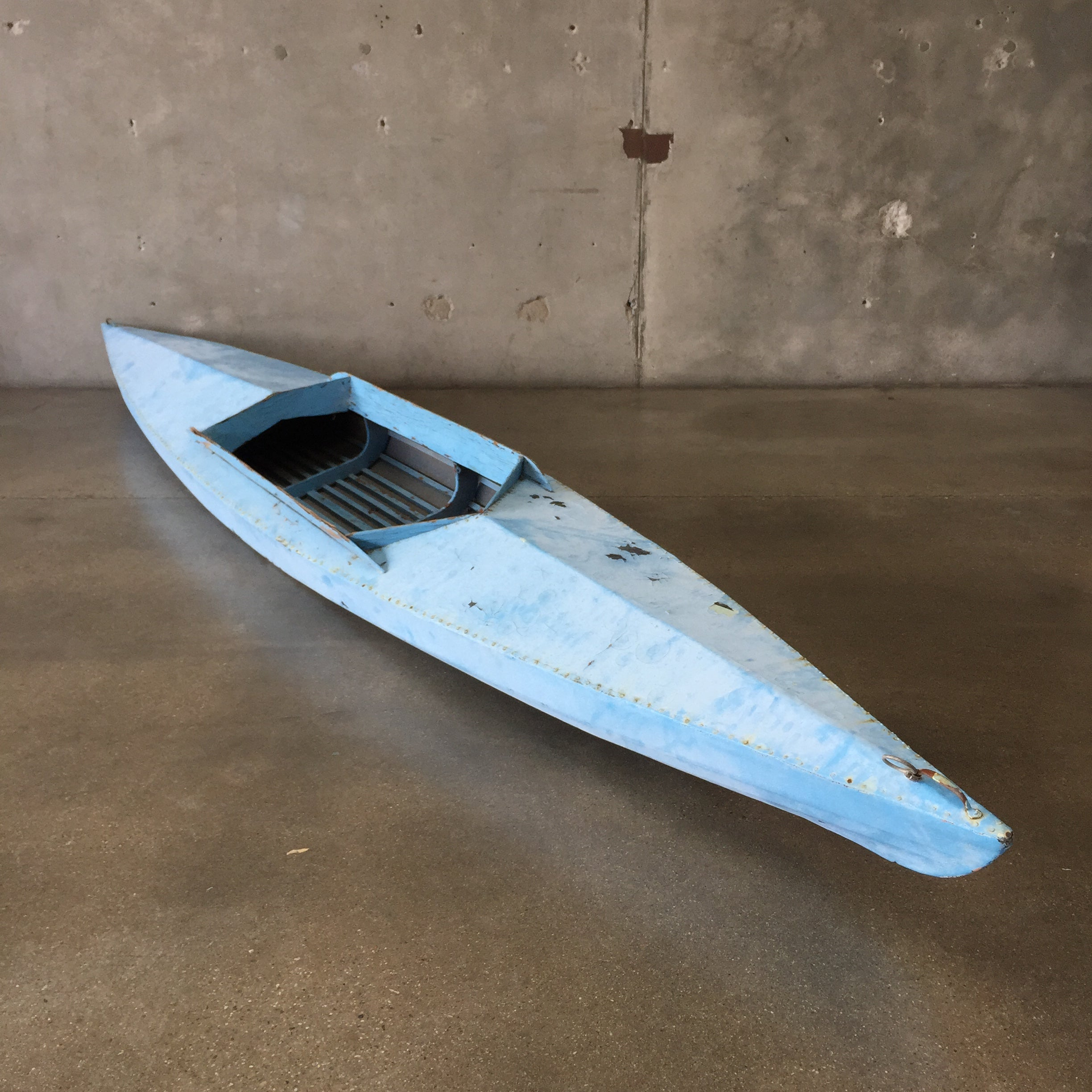1950 s canvas blue kayak with paddle