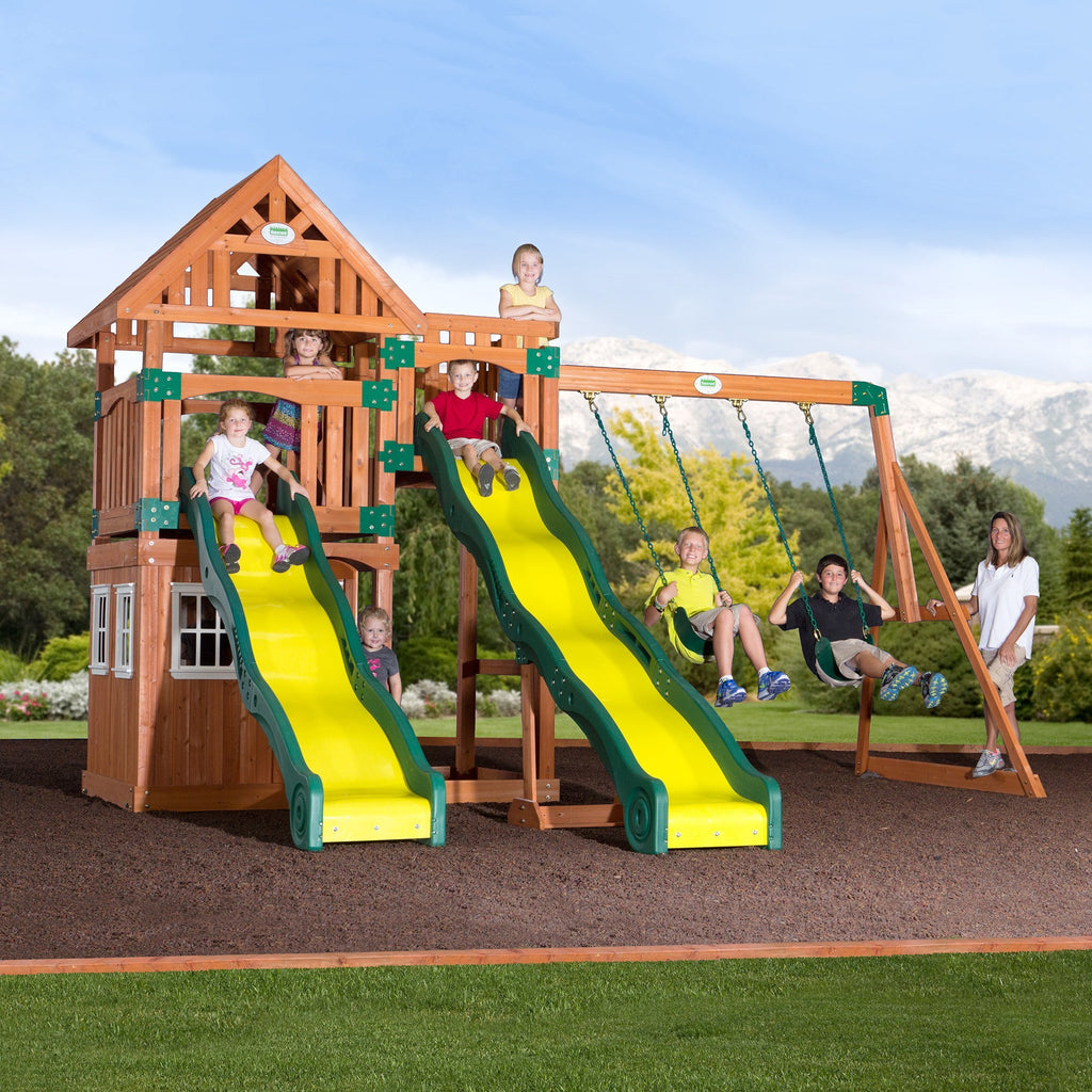wooden swing sets a wooden swing set with a playhouse and slide