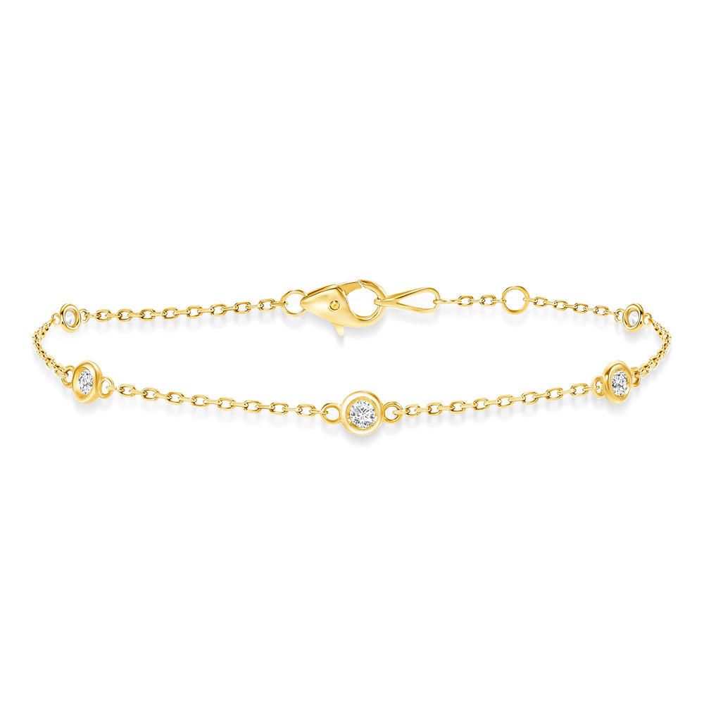 yellow gold diamond bezel train bracelet