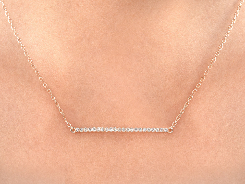 white gold vertical bar necklace on woman