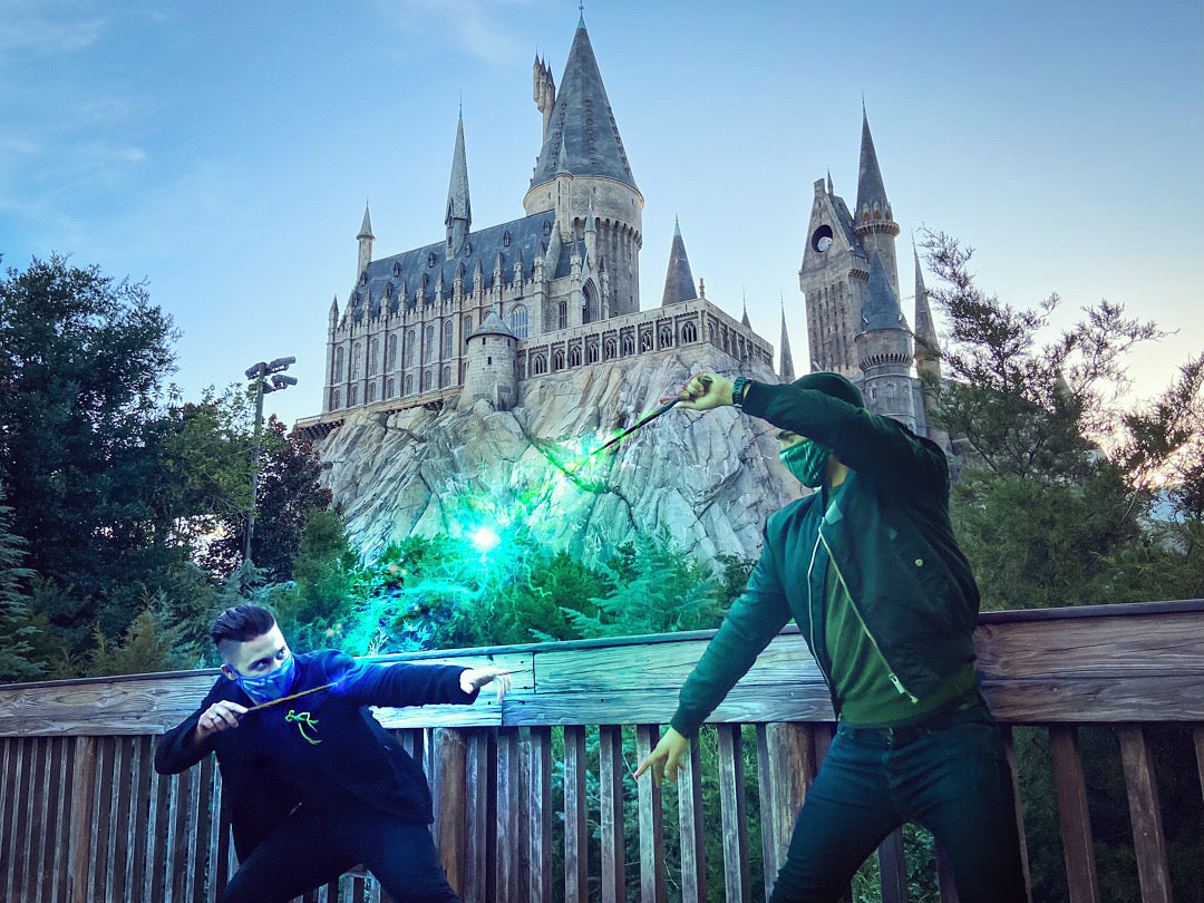 Mitchell dueling with magic in front of Hogwarts castle