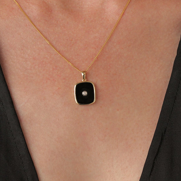 """Be the Light"" Black Onyx and Diamond Yellow Gold Rectangular Pendant"