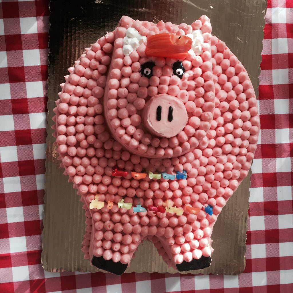 Two-tiered cake shaped to look like a pig.
