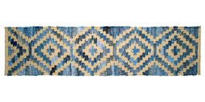 Coastal style upcycled denim blue and sustainable jute table runner in Aztec pattern.
