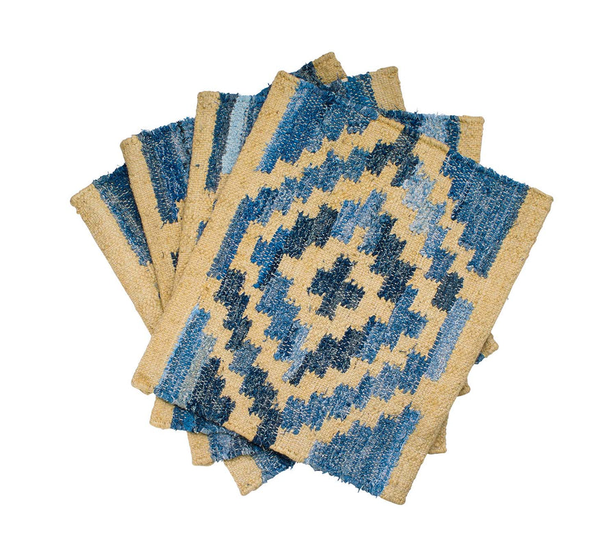 Coastal style upcycled denim blue and sustainable jute placemats in Aztec pattern.