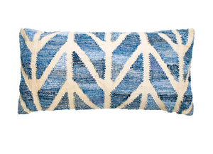 Coastal style denim blue and sustainable jute rectangle cushion in herringbone pattern.